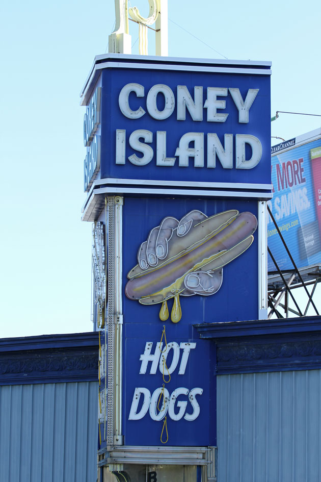 On the Coney Island sign in Worcester, the mustard drips in neon. (Andrew Phelps/WBUR)