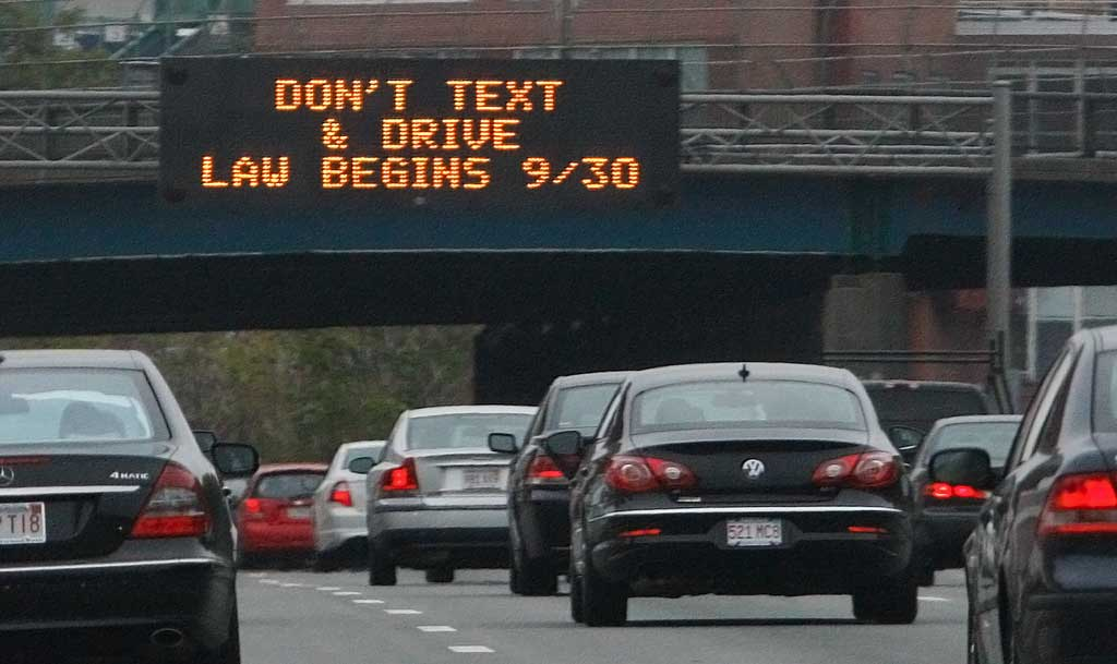 A sign over the Massachusetts Turnpike in Boston alerts drivers to a new state law banning texting while driving. (Bill Sikes/AP)