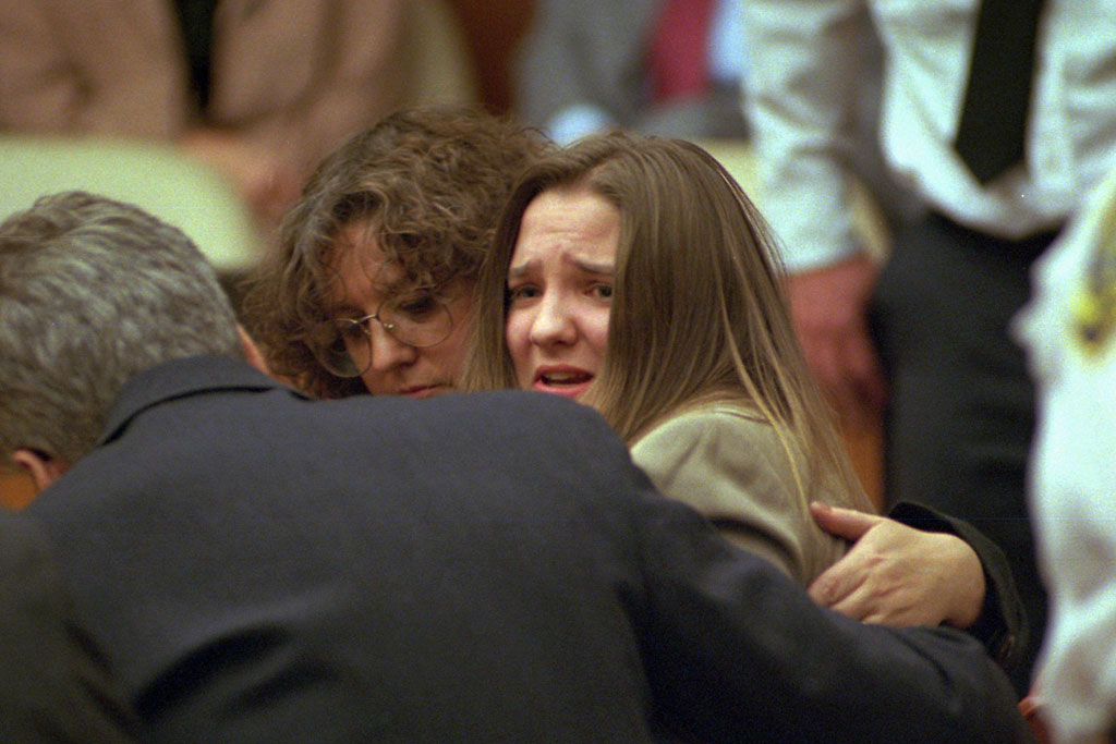British au pair Louise Woodward in Middlesex Superior Court as a jury finds her guilty of second-degree murder in the death of infant Matthew Eappen, who died in her care in February 1997.  In foreground is defense attorney Andrew Good, and in background Elaine Whitfield-Sharp, a member of the defense team. (Pool photo by Ted Fitzgerald via AP)