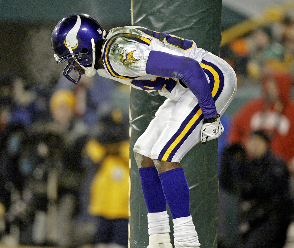 "Then-Minnesota Vikings receiver Randy Moss pretends to ""moon"" the crowd after catching a 34-yard touchdown pass in an away game against the Green Bay Packers in 2005. (AP)"