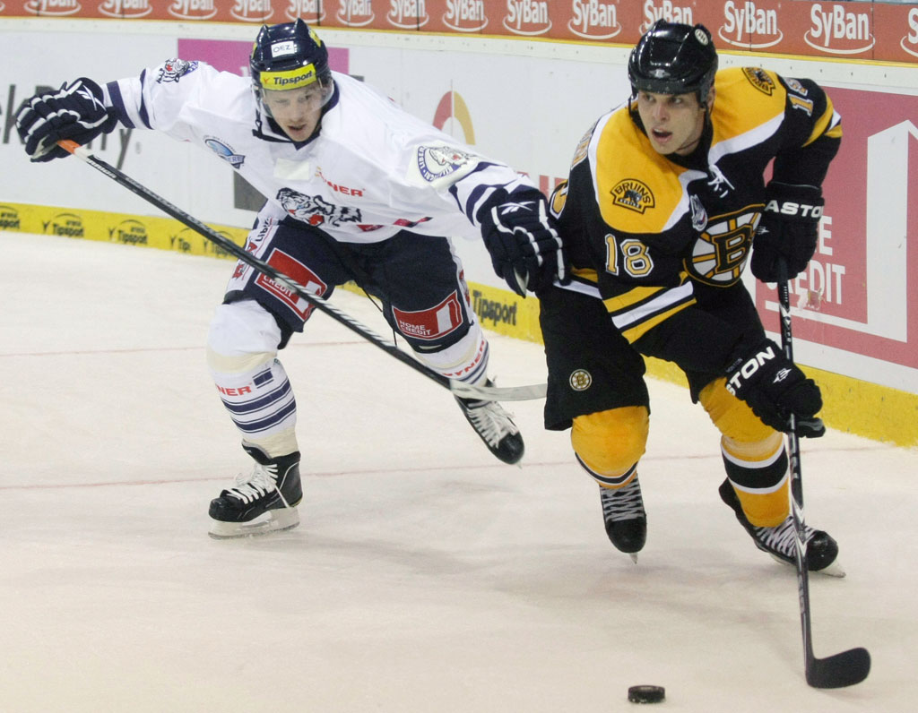 Boston Bruins' Nathan Horton, right, controls a puck ahead of Martin Cakajik, left, of Bili Tigri Liberec during the first period of a preseaso game on Tuesday, Oct. 5. (Petr David Josek/AP)