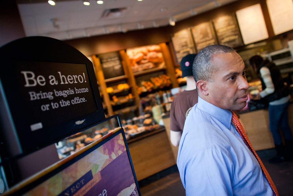 Gov. Deval Patrick waits in line to order lunch before talking with WBUR's Bob Oakes about the 2010 Massachusetts gubernatorial campaign. (Dominick Reuter for WBUR)