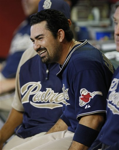 Red Sox fans hope to see first baseman Adrian Gonzalez smiling on a Fenway bench this year. (AP)
