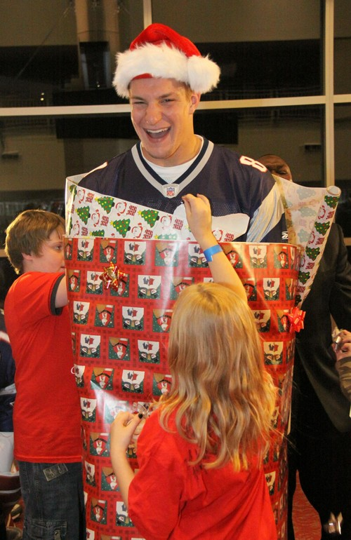 Pats tight end Rob Gronkowski got wrapped up at a charity event on Sunday. (Courtesy of New England Patriots)