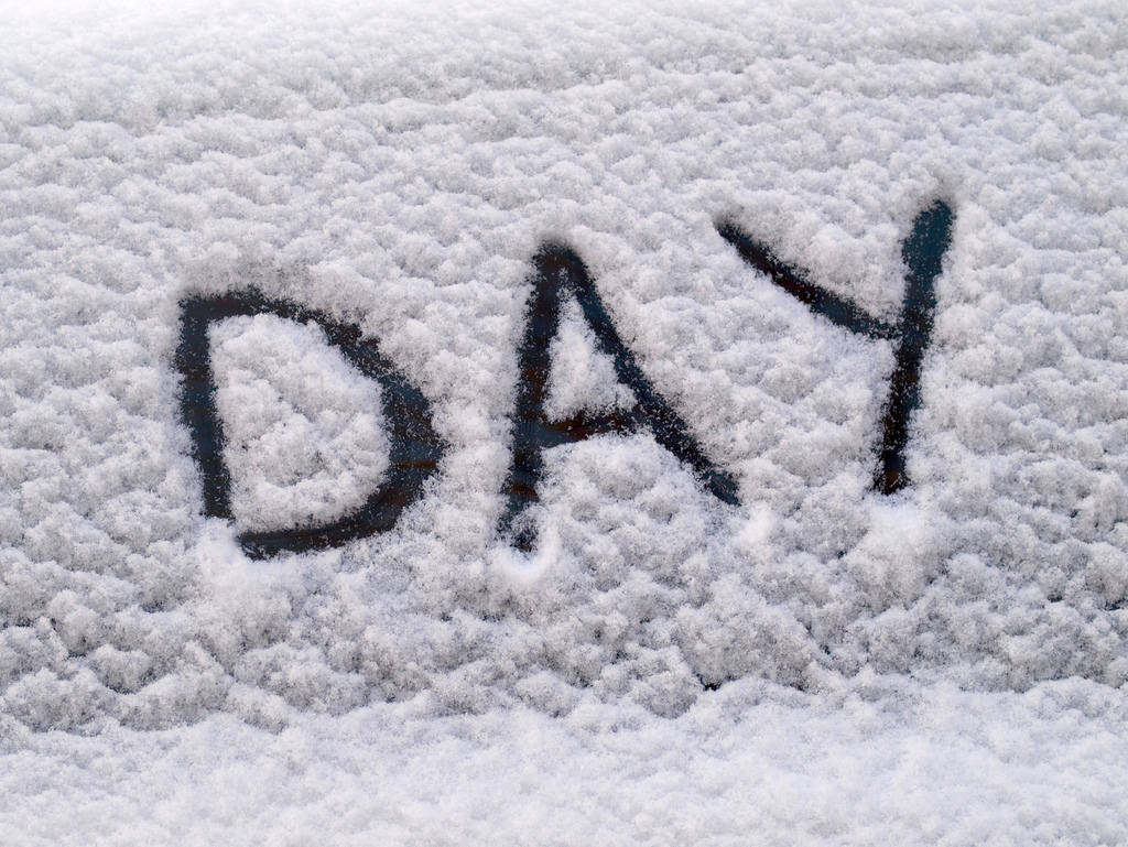 """Day"" written in snow"