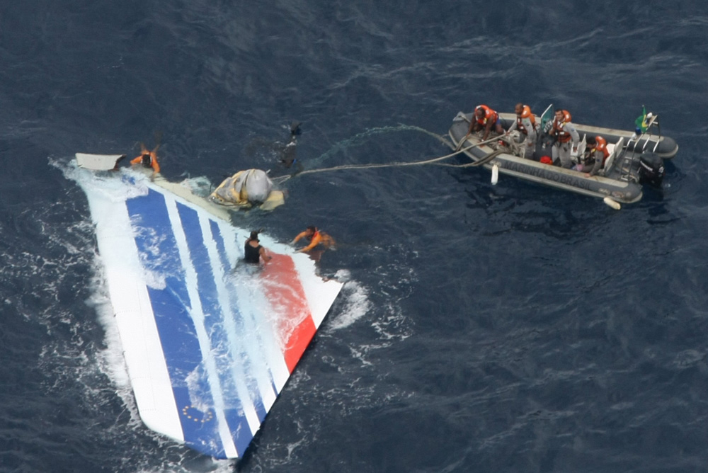 In this June 8, 2009 file photo released by Brazil's Air Force, Brazil's Navy sailors recover debris from the missing Air France Flight 447 in the Atlantic Ocean. (AP)